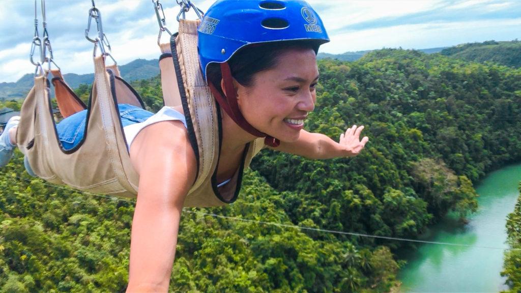 Ziplining at Loboc River, Bohol | Amazing Travel Photography Gear | TravelingPetiteGirl.com